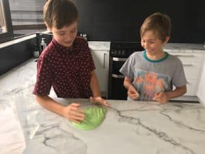 TWO BOYS PLAYING WITH GREEN SLIME IN KITCHEN