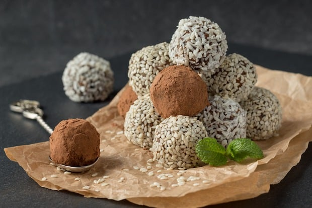 bliss balls with coconut, sesame seeds and chocolate powder. amazing amazeballs