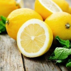 cut lemons on wood