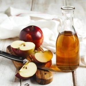 cut apples on timber board, apple cider vinegar