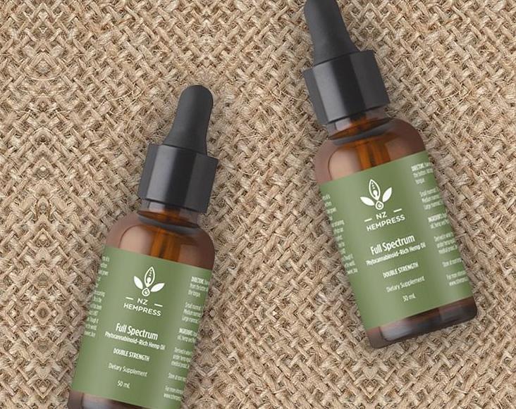 full spectrum hemp oil, two bottles laying down