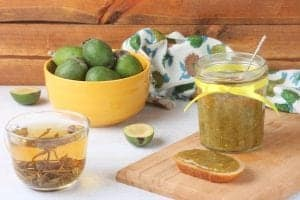 feijoa jam in a jar and on toast beside a bowl of feijoas